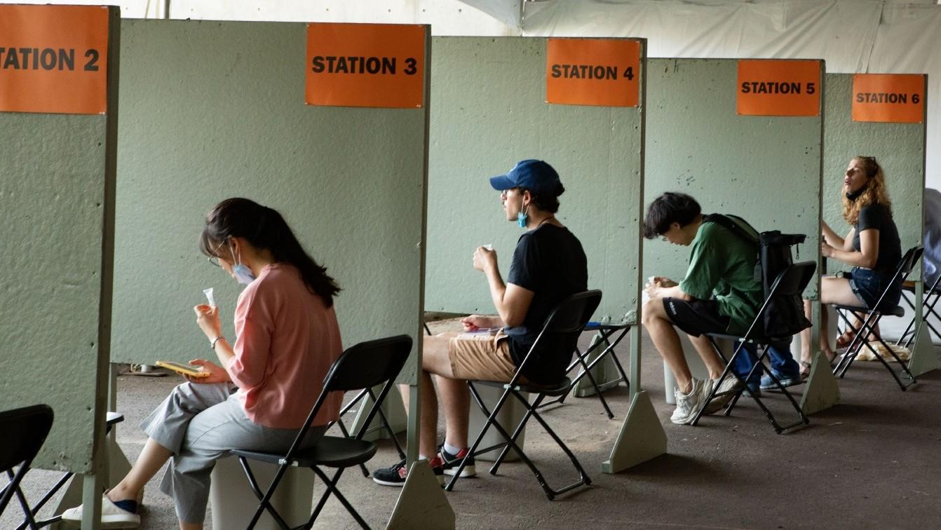 Students await COVID tests at Princeton Stadium clinic